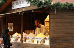 Man sales bath salt at christmas market Royalty Free Stock Photography