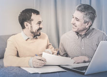 Man and sales manager discuss contract Stock Photos