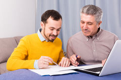 Man and sales manager discuss contract Royalty Free Stock Image