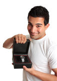 Man or salesman advertising a wristwatch. A friendly man or salesman holds a watch timepiece displayed in a box royalty free stock image