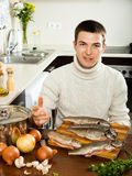 Man with salmon fish Royalty Free Stock Image