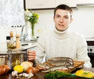 Man with salmon fish Stock Photography