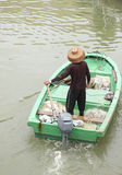 Man on sampan boat Stock Photo