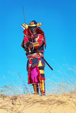 Man in samurai costume with sword. Samurai in ancient armor in a field with sword. Original Character Stock Photography
