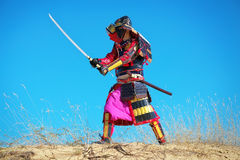 Man in samurai costume with sword. Stock Photo