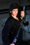 Man samurai sword. Young handsome man with samurai sword, grunge photography style Stock Image