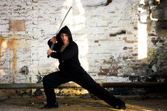 Man samurai sword. Young handsome man with samurai sword, grunge photography style Royalty Free Stock Photos