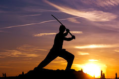 Man samurai sword sky. Silhouetted man with samurai sword against sunset sky Stock Images