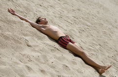 Man on sand stock photo