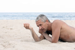 Man with sand in hand Royalty Free Stock Image