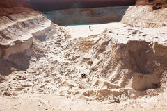 Man in sand quarry Royalty Free Stock Images