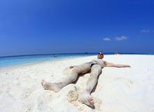 The man in the sand Stock Photography