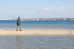 Man on sandbank Stock Photography