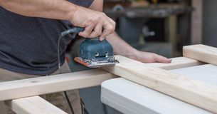 Man Sanding a DIY Project stock image