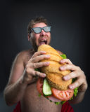Man with sandwich royalty free stock photos