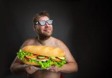 Man with sandwich stock photo