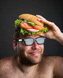 Man with sandwich on his head Stock Photography
