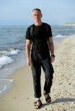 Man on sandy beach Royalty Free Stock Photo