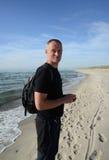 Man on sandy beach Royalty Free Stock Photos