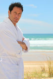Man on a sandy beach Royalty Free Stock Photography