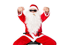 Man in Santa Claus clothes shows fig Stock Photo