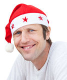 Man in Santa Claus hat . Stock Photography