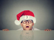 Man in santa claus hat with question mark Stock Images