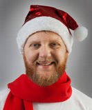 Man in a Santa Claus hat and red scarf Royalty Free Stock Photos
