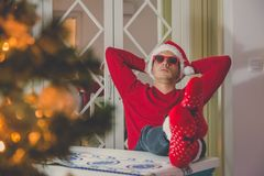 Young modern guy enjoying Christmas spirit royalty free stock images