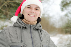 Man in Santa Claus hat Stock Images