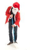 Man in Santa clothes with mop Stock Photography