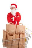 Man in Santa clothes with paper bags Royalty Free Stock Images