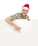 Man in Santa hat Stock Images