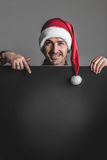 Man in Santa hat with banner Stock Photos