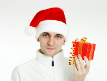 Man in a Santa hat with Christmas gift Royalty Free Stock Image