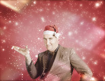 Man in santa hat displaying christmas copyspace Royalty Free Stock Photography
