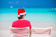 Man in Santa hat enjoy summer vacation on tropical Stock Photography