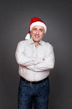 Man in santa hat with folded hands Royalty Free Stock Photo