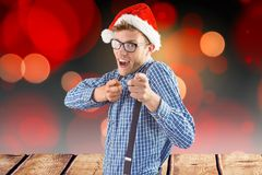 Man in santa hat gesturing against digitally generated background Royalty Free Stock Photo