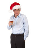 Man in Santa Hat Holding Drink Stock Images
