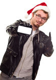 Man with Santa Hat Holding Out Blank Cell Phone. Smiling Young Man with Santa Hat Holding Out Blank Cell Phone Isolated on a White Background stock images