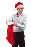 Man in Santa Hat Horrified Stocking Royalty Free Stock Photos