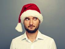Man in santa hat looking at something Royalty Free Stock Image