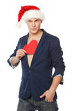 Man in Santa hat pulling out a heart shape Royalty Free Stock Photo