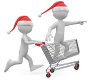 Man with Santa hat pushing a shopping cart Stock Photo