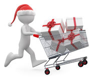 Man with Santa hat pushing a shopping cart full of Stock Images