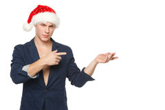 Man in Santa hat showing empty space Royalty Free Stock Photography