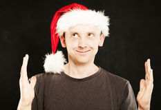 Man in Santa Hat showing his Hands Royalty Free Stock Images