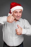 Man in santa hat showing thumbs up Stock Photography