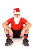 Man in Santa hat sitting Stock Image